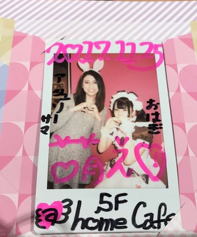 Me posing with a maid on the instax souvenir photo
